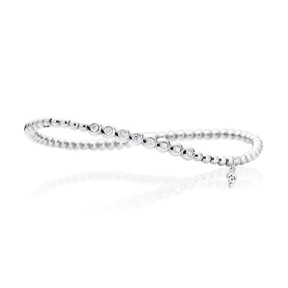 "Armband ""Flessibile"" 750WG, 8 Diamanten Brillant-Schliff 0.20ct TW/vs, Innenumfang 17.0 cm"