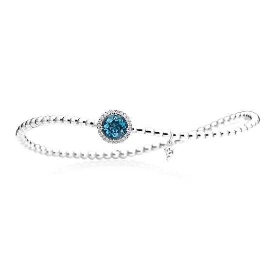 "Armband ""Espressivo"" 750WG, Topas London blue facettiert Ø 6.0 mm ca. 0.90ct, 22 Diamanten Brillant-Schliff 0.06ct TW/si1, Innenumfang 17.0 cm"