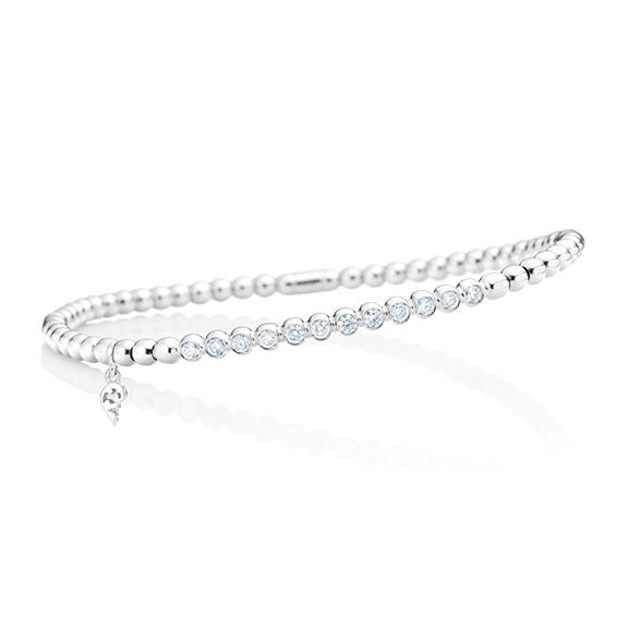 "Armband ""Flessibile"" 750WG, 12 Diamanten Brillant-Schliff 0.40ct TW/si, Innenumfang 17.0 cm"