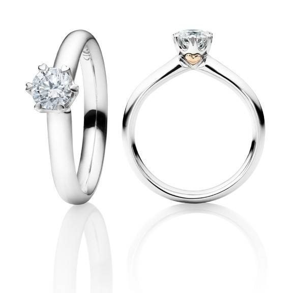 "Ring ""Diamante in Amore"" 750WG 6-er Krappe mit seitl. RG-Herz, 1 Diamant Brillant-Schliff 1.00ct TW/vs1 GIA Zertifikat, 1 Diamant Brillant-Schliff 0.005ct TW/vs1"