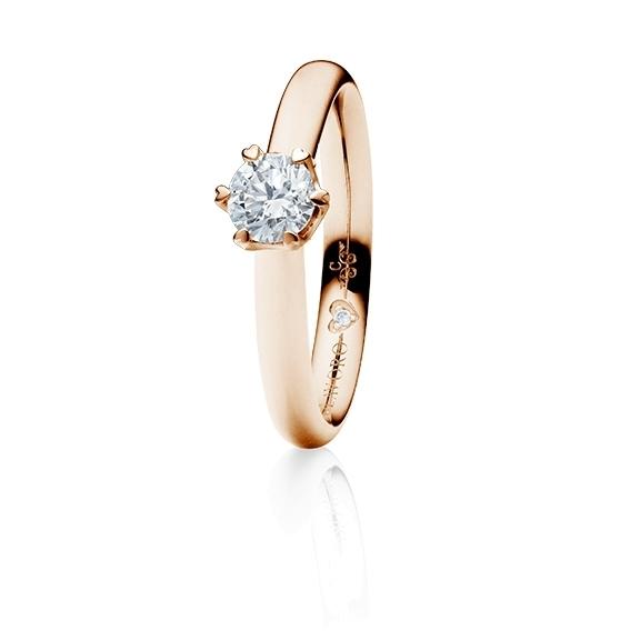 "Ring ""True Love"" 750RG 6-er Krappe mit seitl. WG-Herz, 1 Diamant Brillant-Schliff 0.50ct TW/vs1,  1 Diamant Brillant-Schliff 0.005ct TW/vs1"