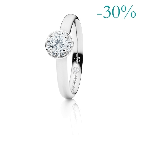 """Ring """"Diamante in Amore"""" 750WG Zargenfassung mit 4-er Krappe + Fadenfassung, 1 Diamant Brillant-Schliff 0.10ct TW/vs1, 8 Diamanten Brillant-Schliff 0.01ct TW/vs1, 1 Diamant Brillant-Schliff 0.005ct TW/vs1"""