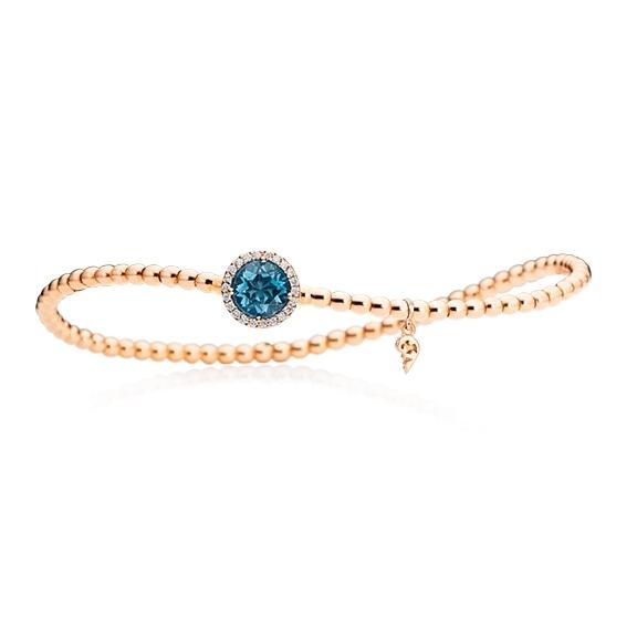 "Armband ""Espressivo"" 750RG, Topas London blue facettiert Ø 6.0 mm ca. 0.90ct, 22 Diamanten Brillant-Schliff 0.06ct TW/si1, Innenumfang 17.0 cm"