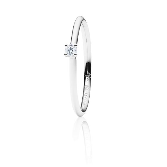 "Ring ""Diamante in Amore"" 750WG 4-er Krappe, 1 Diamant Brillant-Schliff 0.05ct TW/vs1, 1 Diamant Brillant-Schliff 0.005ct TW/vs1"