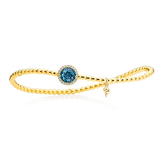 "Armband ""Espressivo"" 750GG, Topas London blue facettiert Ø 6.0 mm ca. 0.90ct, 22 Diamanten Brillant-Schliff 0.06ct F/si1, Innenumfang 17.0 cm"