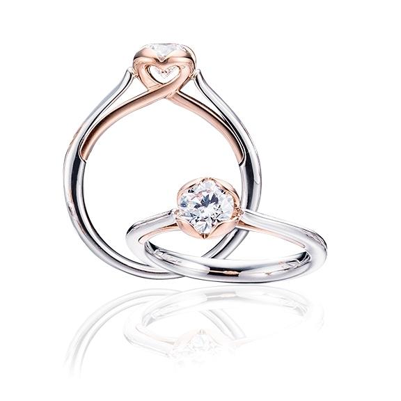 "Ring ""Infinite Love"" 750WG 4-er Krappe 750RG, 1 Diamant Brillant-Schliff 0.25ct TW/vs1"