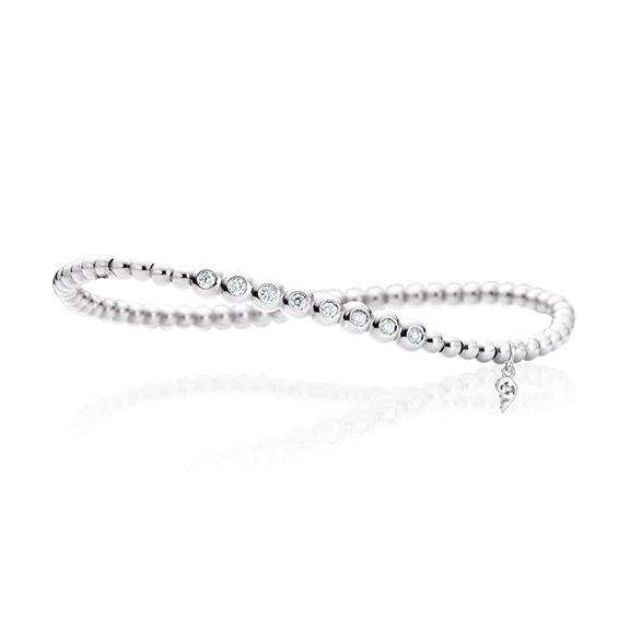 "Armband ""Flessibile"" 750WG, 8 Diamanten Brillant-Schliff 0.20ct TW/si, Innenumfang 17.0 cm"